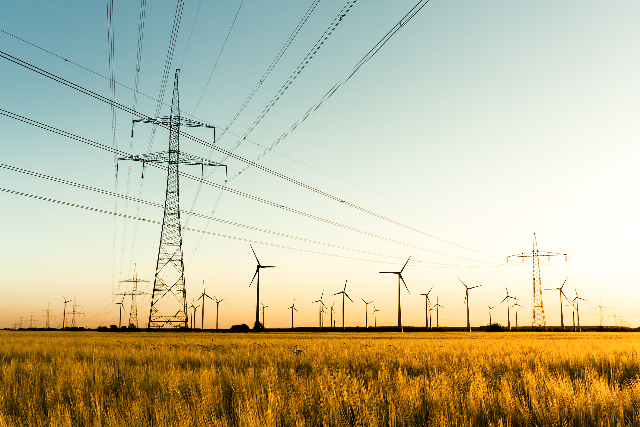 Photo showing wind turbines and high voltage lines