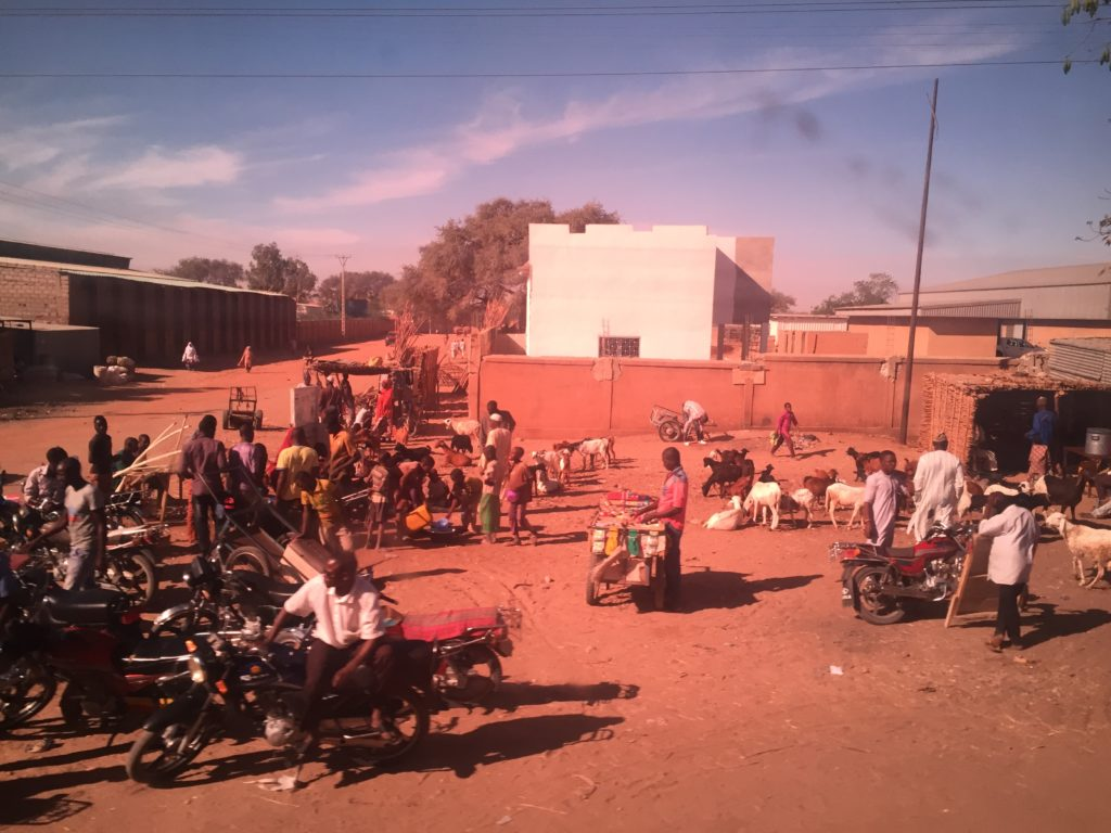 People gather along the Maradi-Niamey highway.