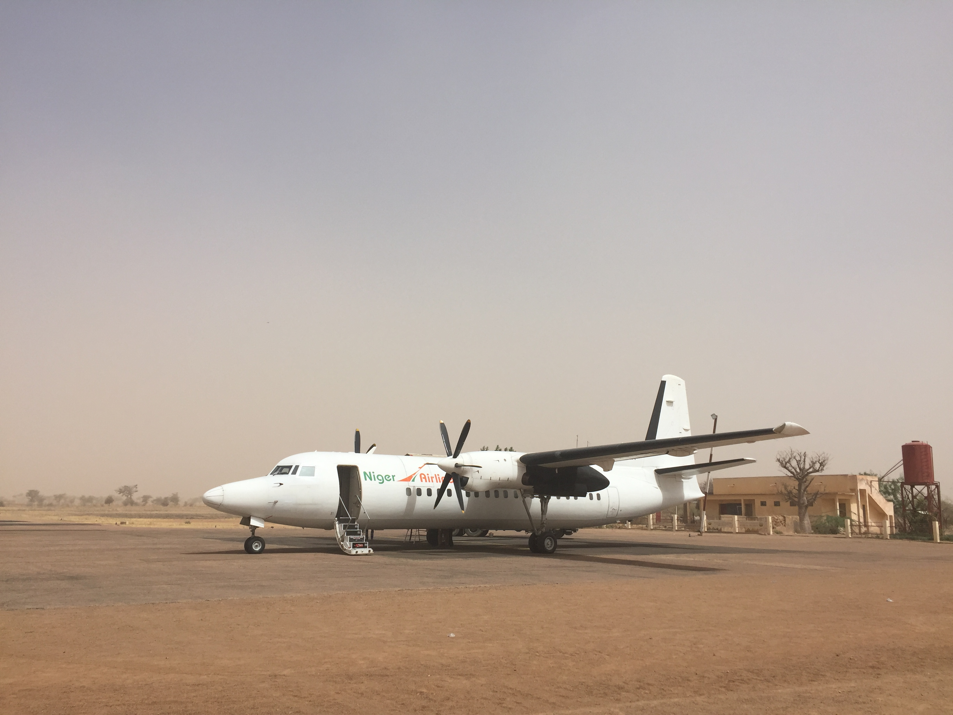 Kabir boarded a 30-year-old Fokker 50 propeller plane in Niamey with the goal of reaching Maradi in the agricultural belt of Niger. Dust storms thwarted this plan.