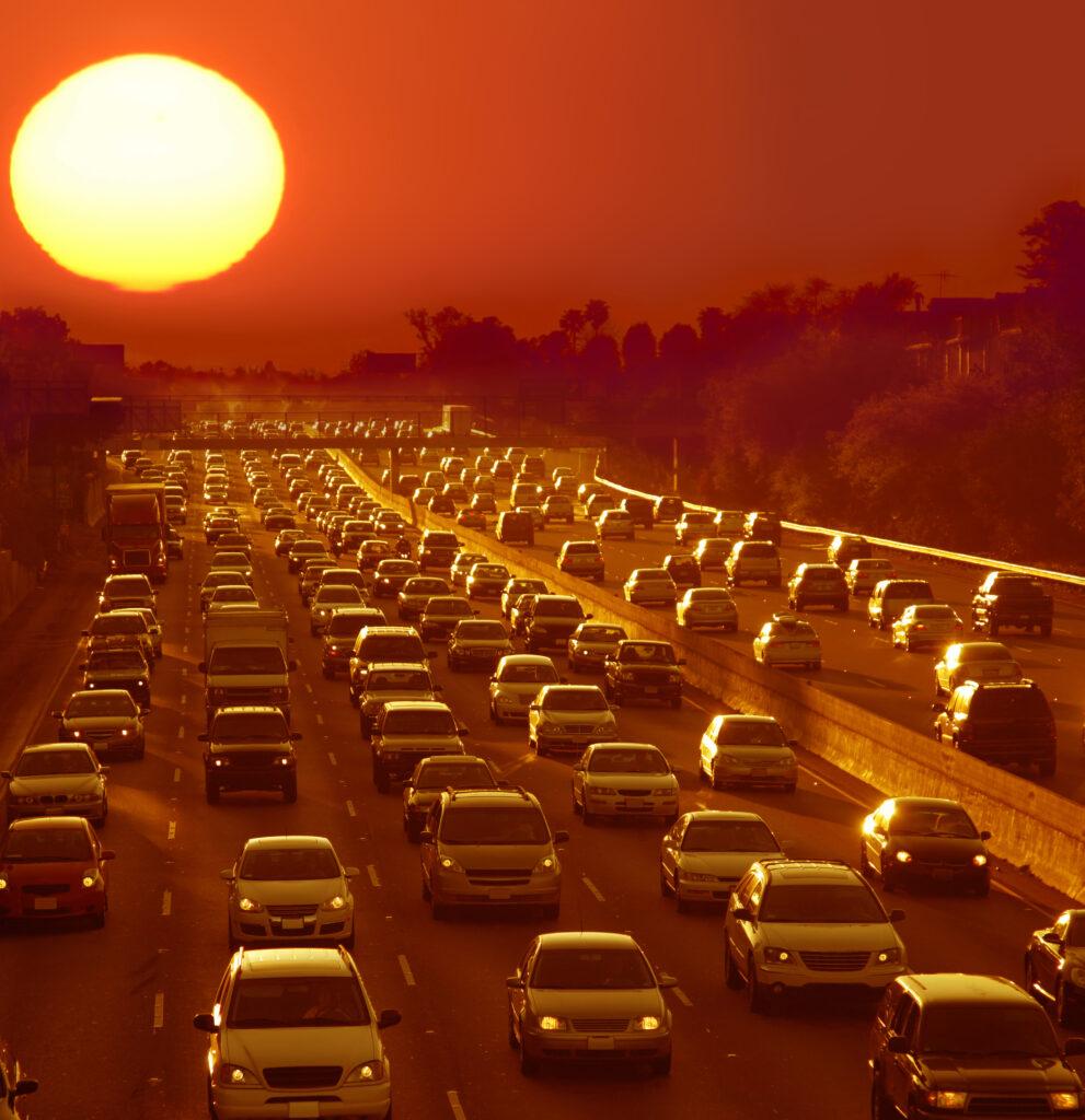 sunset over traffic jam