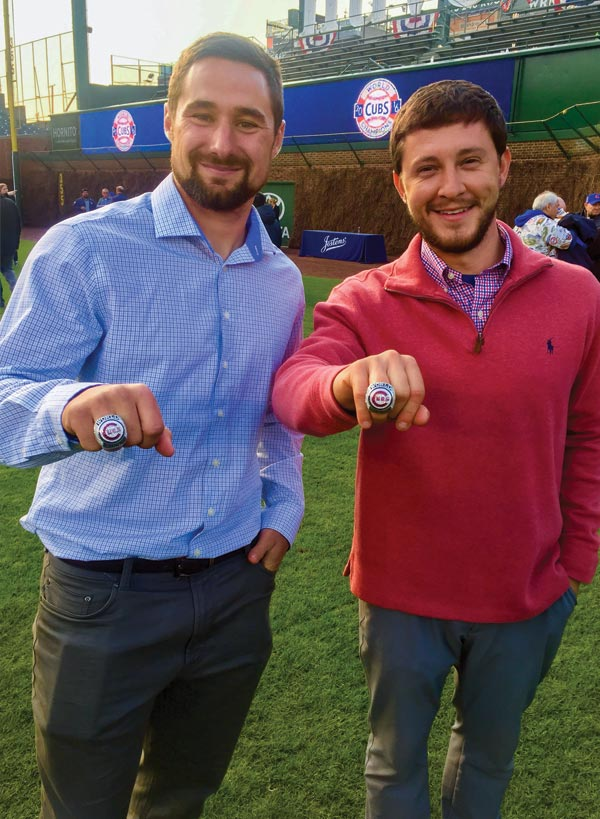 Dan Kiermaier and Ben Baumer display their 2016 Chicago Cubs World Series rings