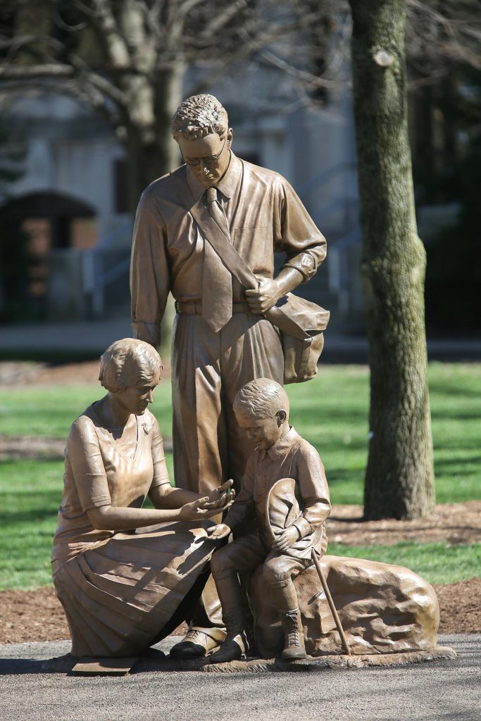 Photo of new statue outside of Ag administration depicting early entomologists
