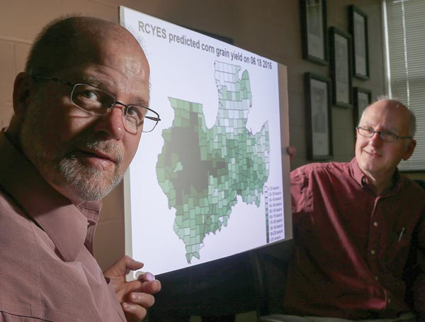 Brad Joern and Philip Hess display predicted 2016 corn yields for the Midwest