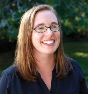 Sarah Williams smiles in an outdoor photograph