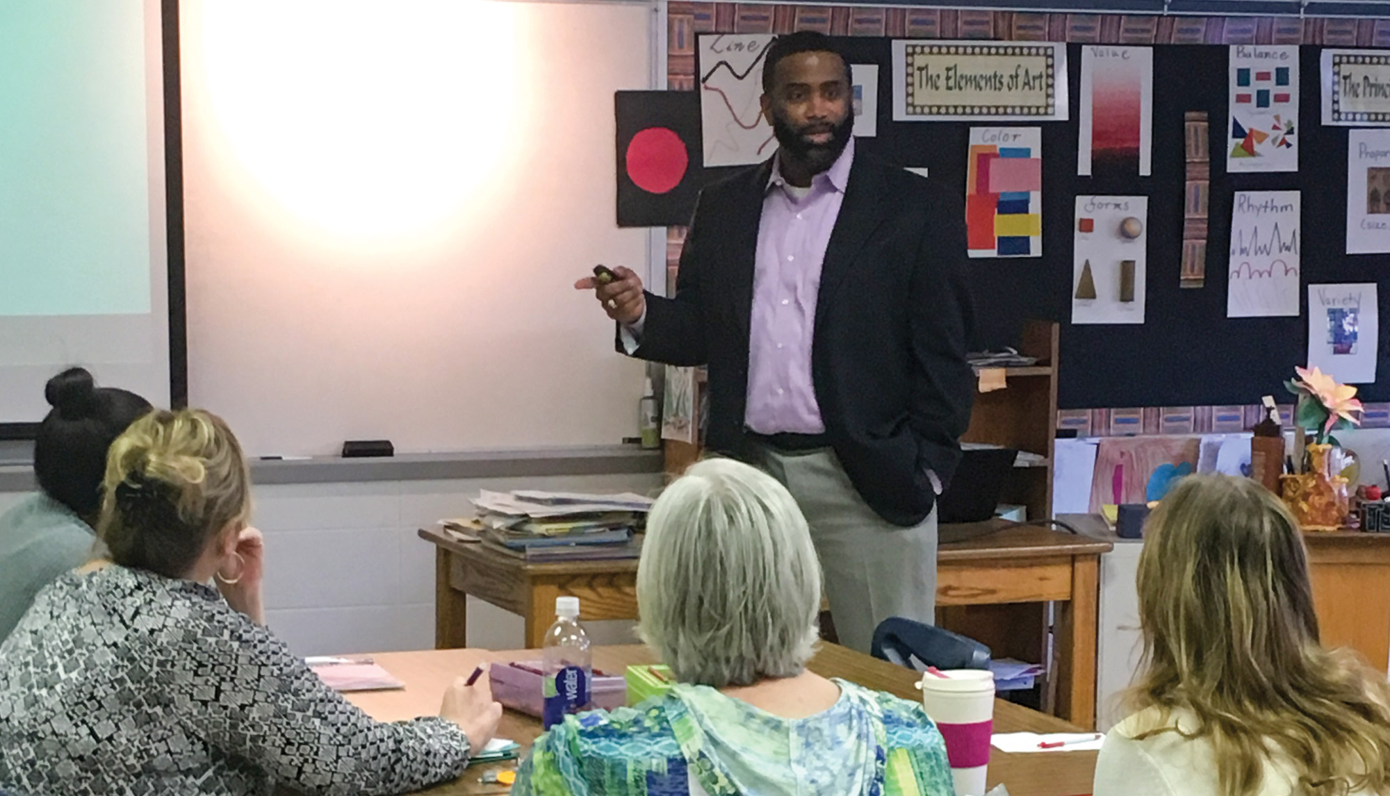 Levon Esters leads a professional development session for educators in the classroom