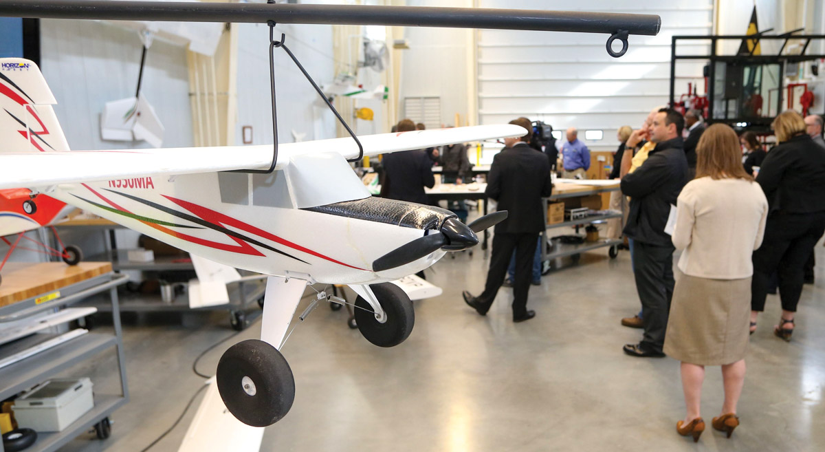 Unmanned aerial vehicles in the foreground of the storage bay are used, along with drones, to fly sensors over fields.