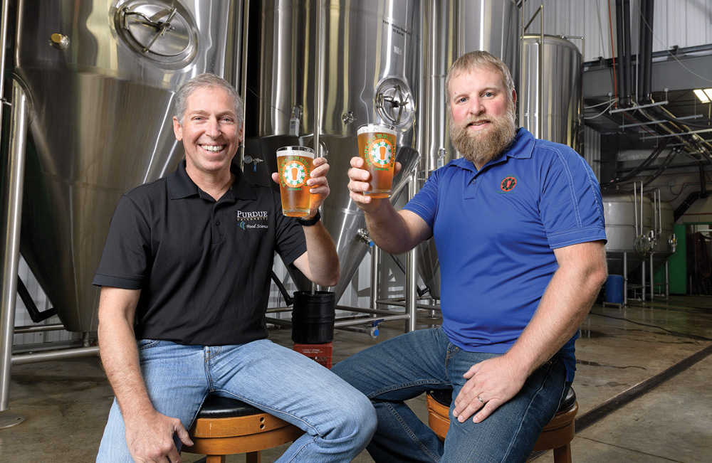 Brian Farkas and Chris Johnson raise a pint of Boiler Gold.
