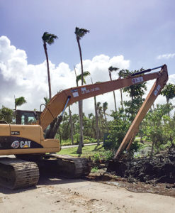 construction equipment does landscape work to repair hurricane damage