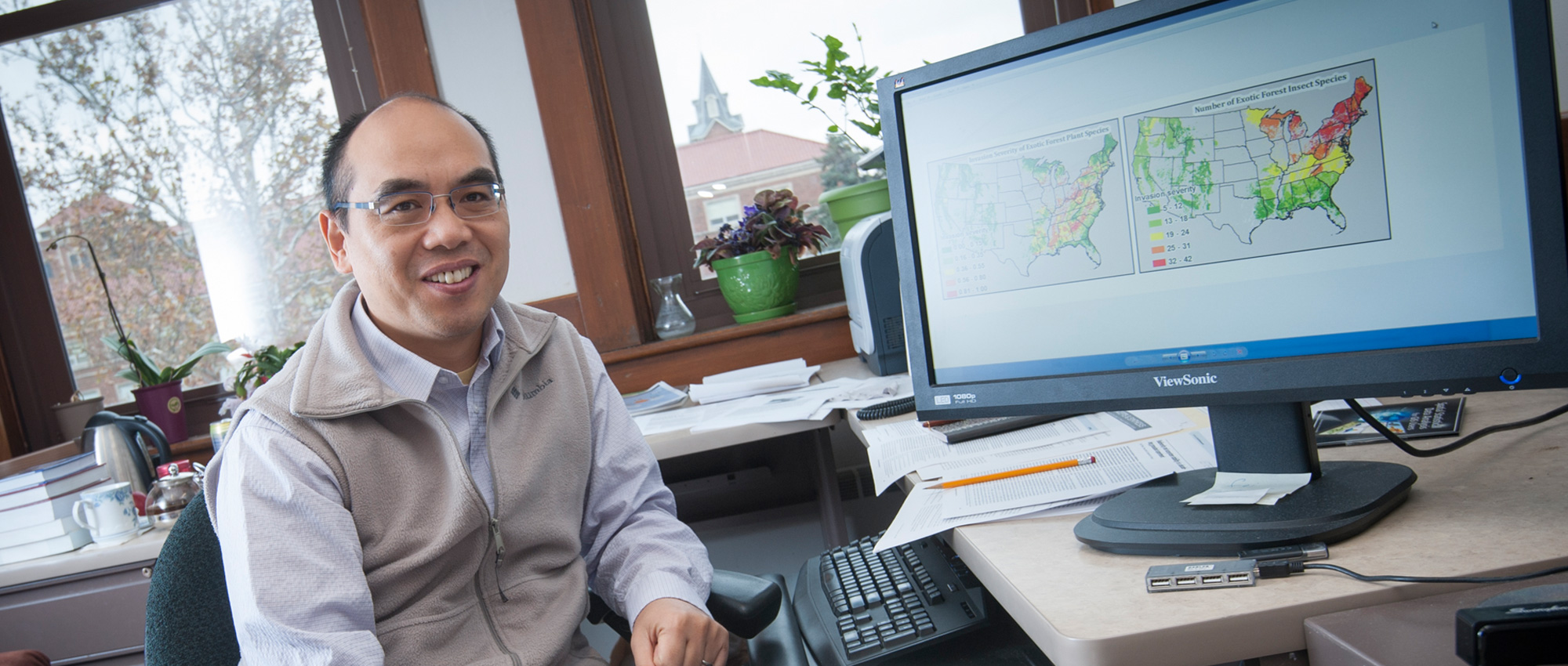 Songlin Fei, associate professor in the Department of Forestry and Natural Resources and researcher with Purdue's Climate Change Research Center, at his computer