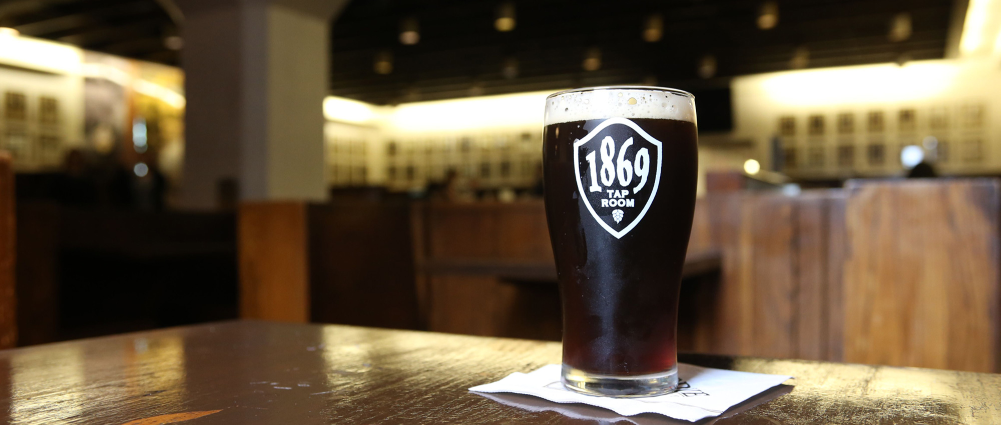a glass of beer in the 1869 Tap Room at Purdue