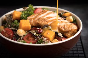 A chicken bowl with vegetables