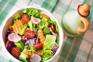 Salad with tomatoes and carrots in a bowl.