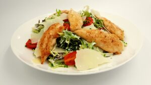 Cesar salad on a white plate