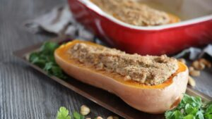 A hollowed out butternut squash filled with brown sugar.
