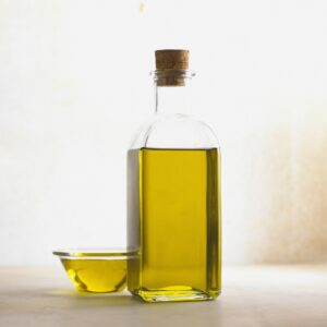 Glass bottle with oil in it.