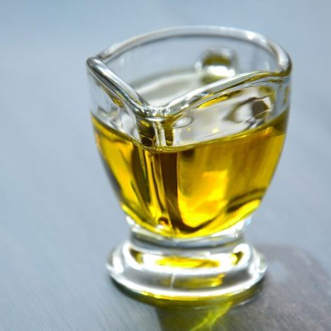 A glass container of oil