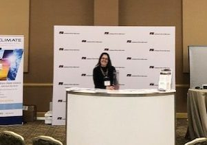 Jonathan Weaver (left) and Beth Hall (right) preparing to present their booth at the Indiana Farm Bureau Conference of 2019.