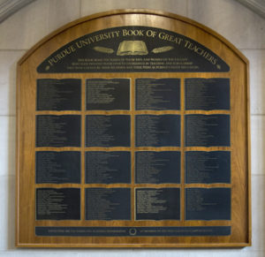 Inductees into the Book of Great Teachers are listed on a bronze-and-walnut wall display in the west foyer of the Union. (Purdue University photo/Mark Simons)