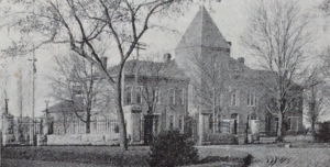 Photo of First College of Agriculture Hall and Experiment Station.
