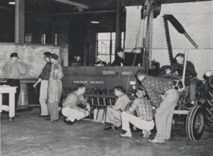 Photo of agricultural engineering students studying equipment, 1958.
