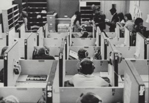 photo of many students closely packed in study cubicles, 1977.
