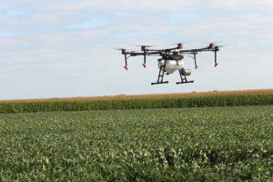 drone flying over field of green
