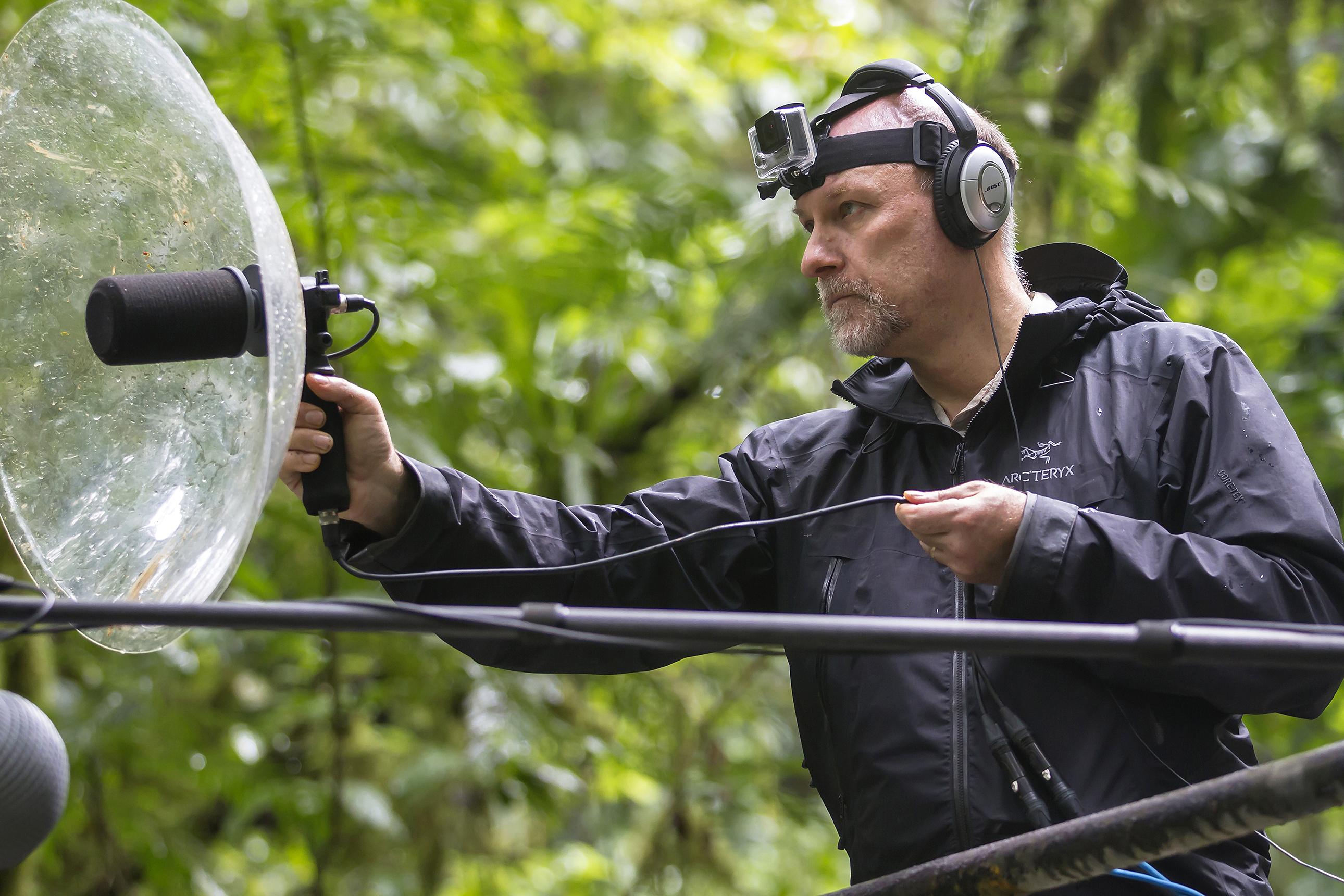 Bryan Pijanowski uses parabolic microphone to listen to nature.