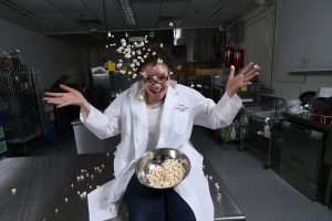 Food Science student, Cameron Wicks, is testing different flavored popcorn.