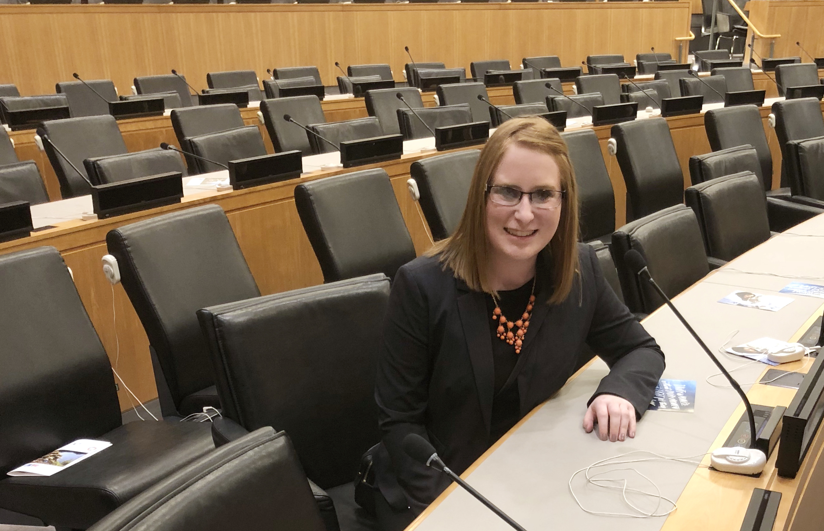 Student sitting in chair at the United Nations