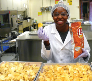 "Photo by Danae Baskin Lauren Hibbler, a senior food science major from Indianapolis, recently took a food processing class that involved studying potato chips. ""A part of our experiment was to see if we could get regular potatoes to compare to Lay's Cheddar and Sour Cream potato chips,"" Hibbler said."