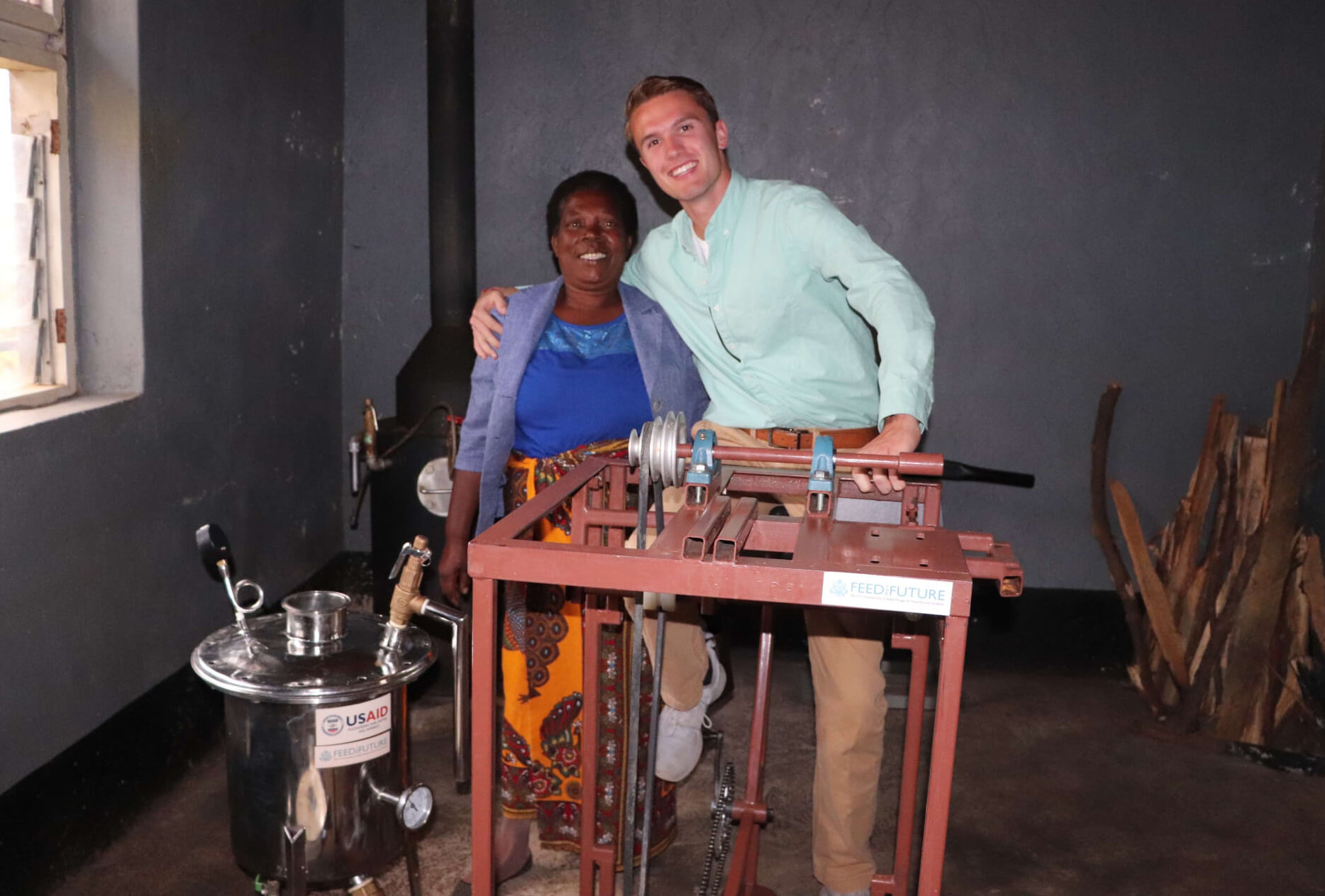 Chapman with a pedal bike used to create power for tomato processing machines at the Mwaiwathu Tomato Processors Cooperative.