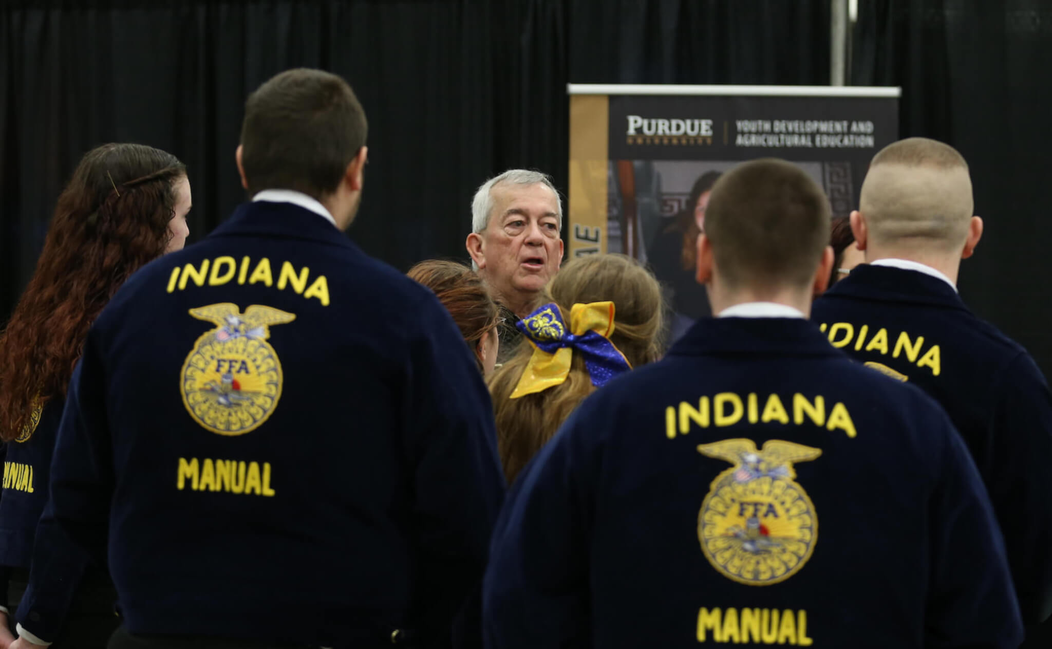 A group of FFA students in jackets learning more about Purdue