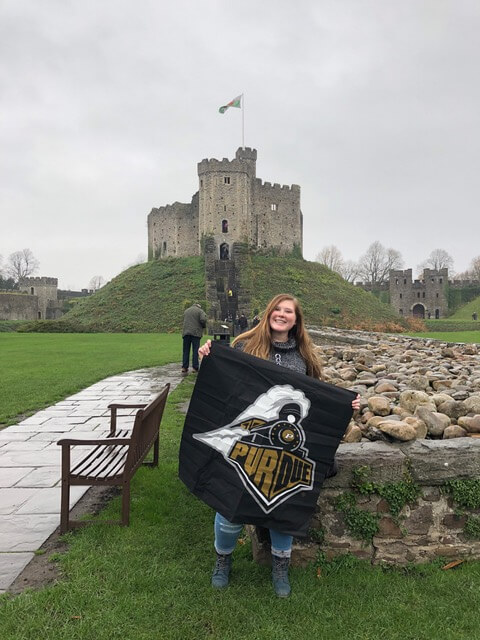 Study Abroad Girl holding Purdue flag