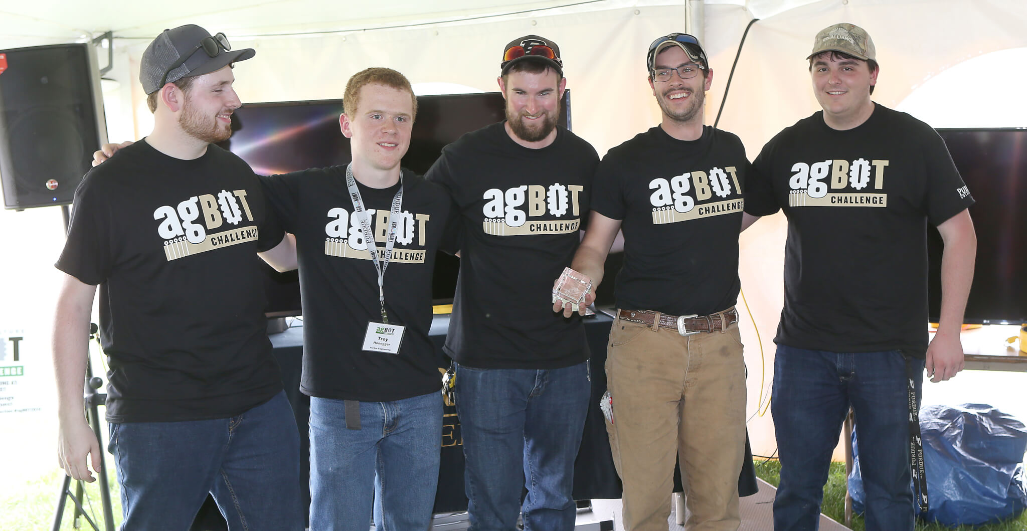 Purdue's agBOT Challenge team accepting their trophy