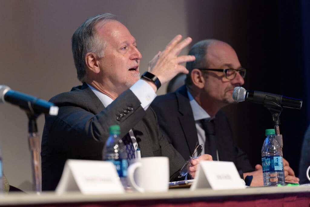 Panel answers questions at microphones during 2017 conference