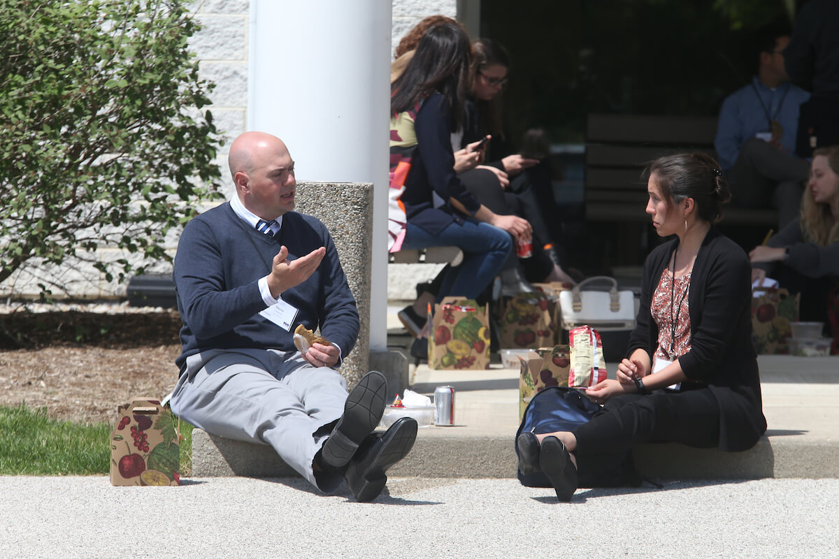 Steve Lindemann having a discuss during a lunch break at the Microbiome Symposium