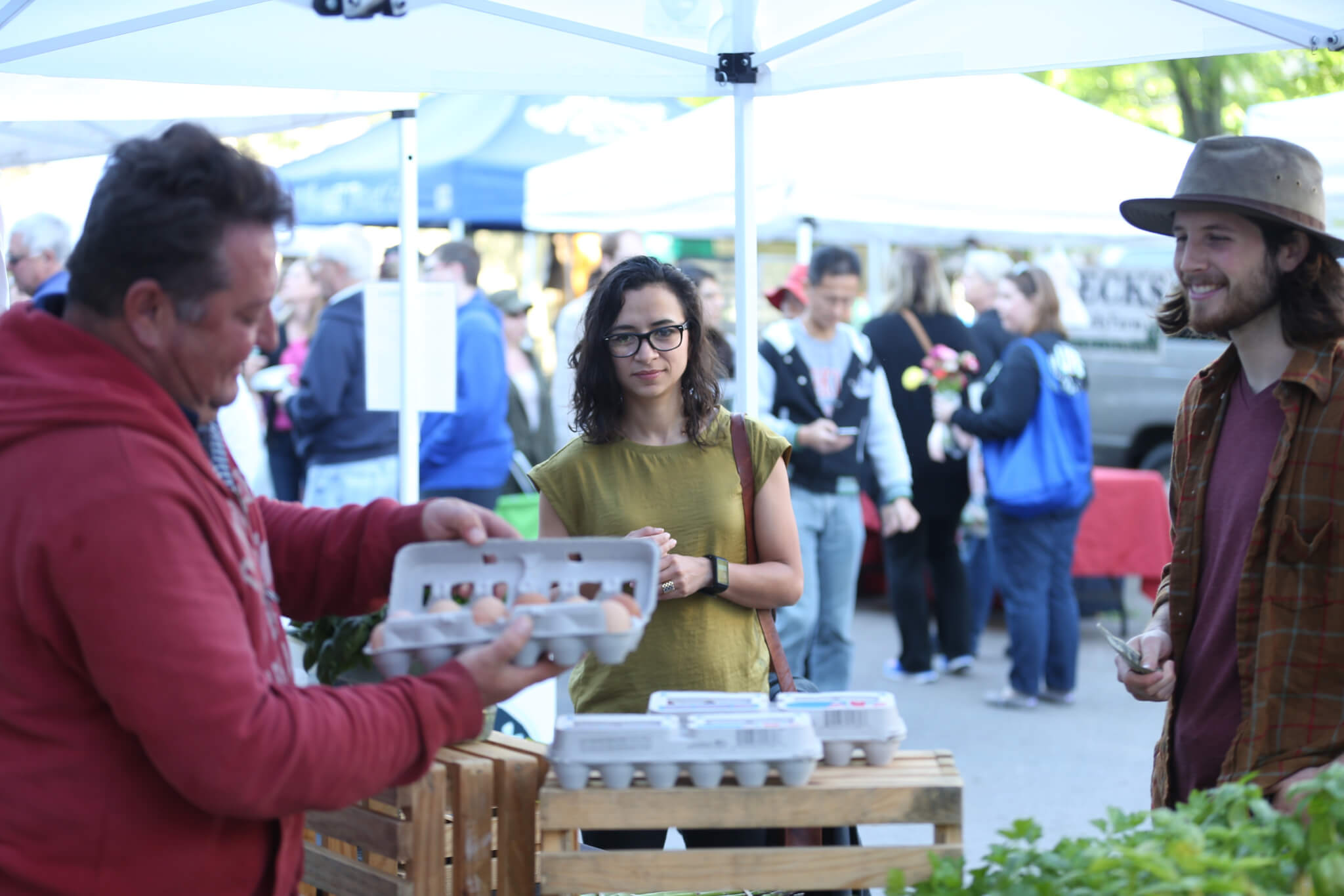 Ariana Torres discusses prices with a grower at the Lafayette Farmers Market.