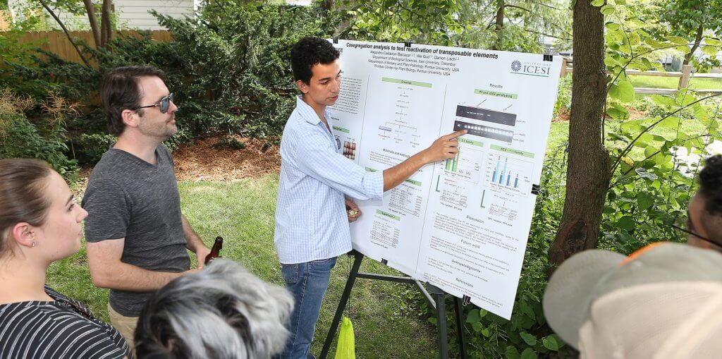 Student presenting outside