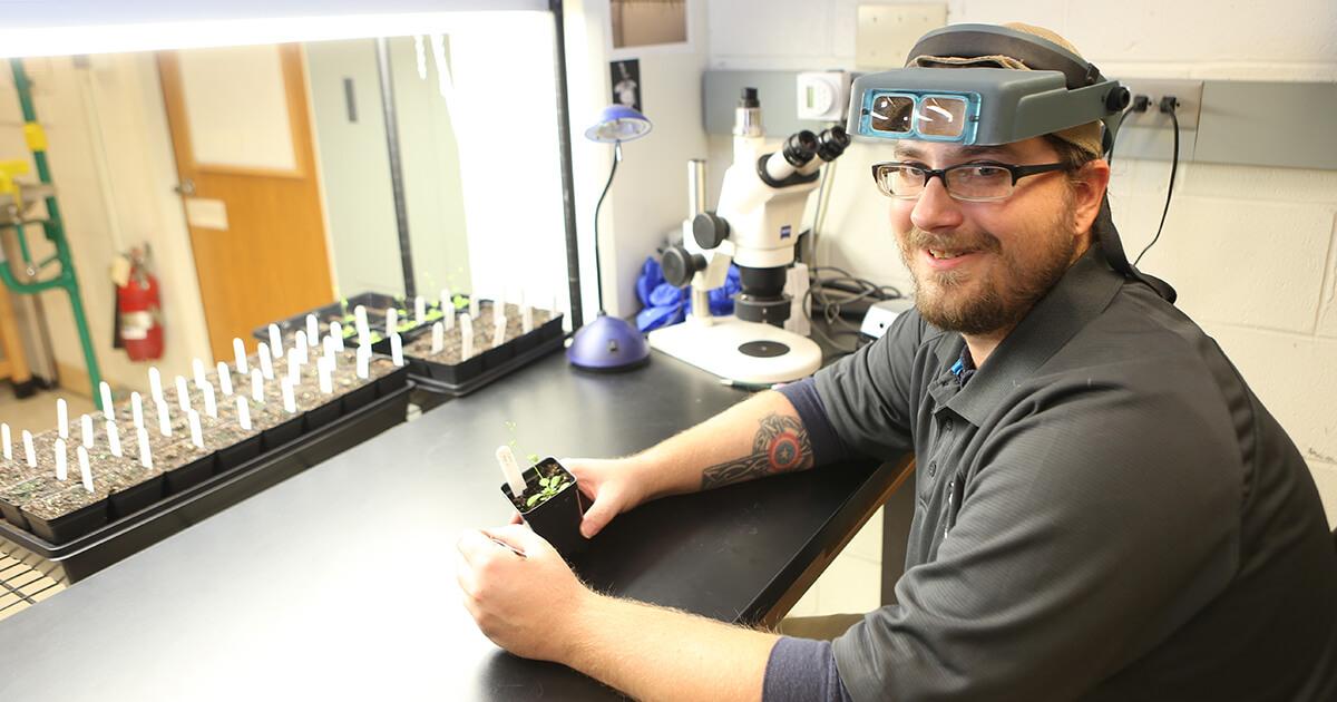 Josh Kraft smiling in the lab