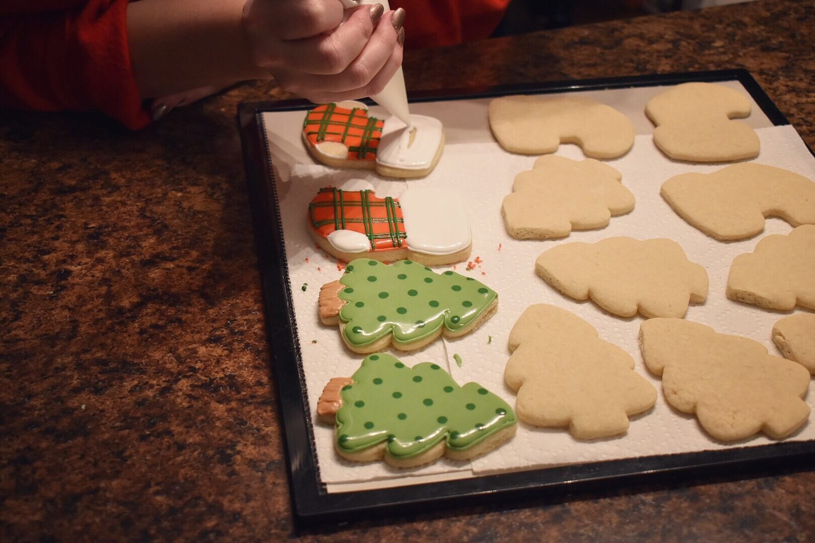 Decorating cookies on a tray