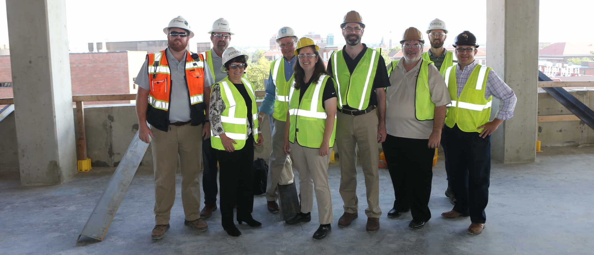 A group of Purdue Agriculture leaders on the top floor of the under construction ABE building