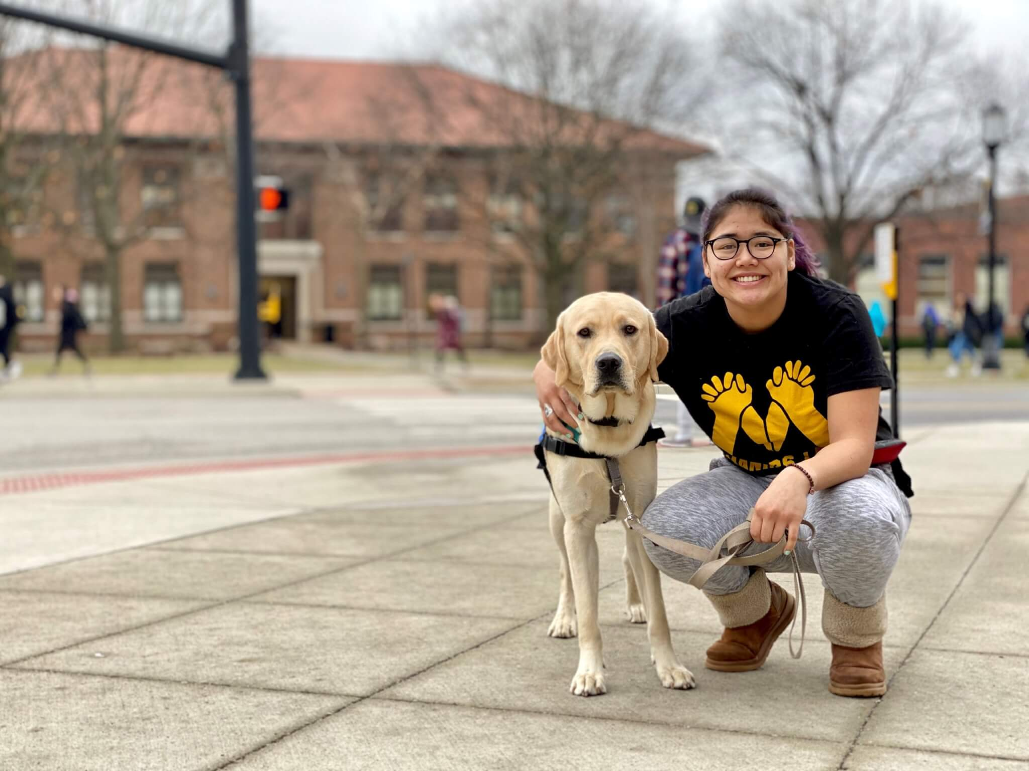 Nira with dog on campus