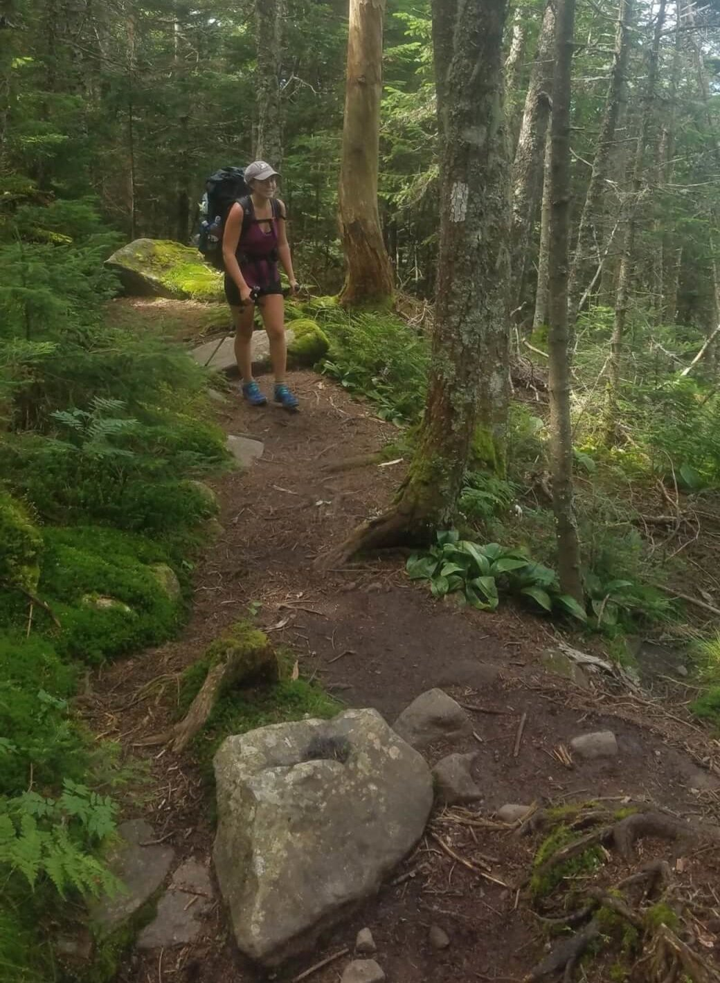 Baleigh hiking up Mount Moosilauke