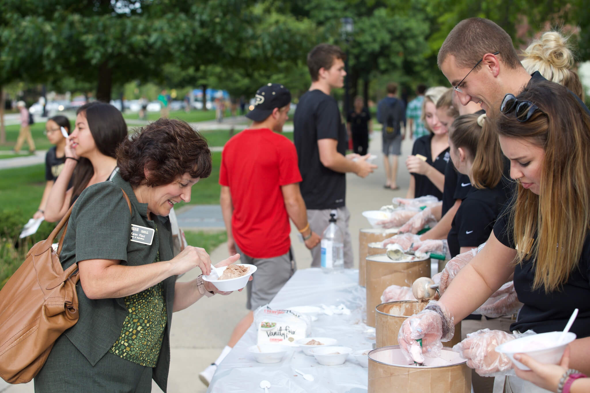 Schwartz serving ice cream to Dean Plaut and others during the Ice Cream Social