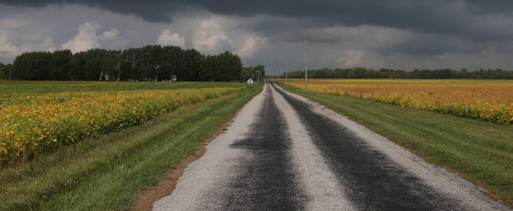 Road with stormy clouds
