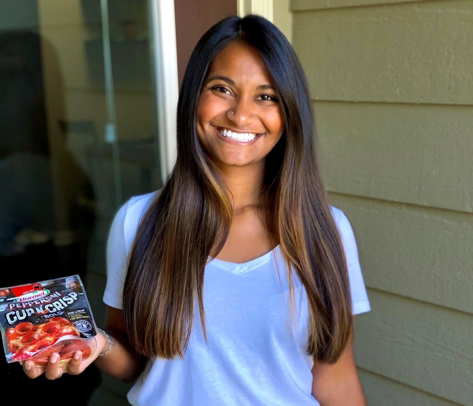 Sneha Jogi holding Hormel pepperoni