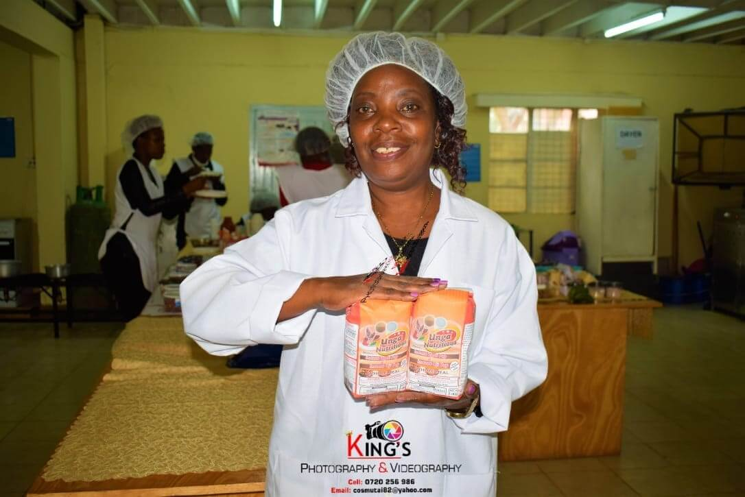 Professor Violet Mugalavai Mugalavai of the University of Eldoret with an Instant Ugali package in the Food Processing Training and Incubation Center.