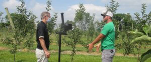 """""""Peter Hirst, Purdue Extension fruit specialist, speaks with Calvin Beasley, owner of Beasley's Orchard, during filming of the virtual fruit and vegetable field day."""""""