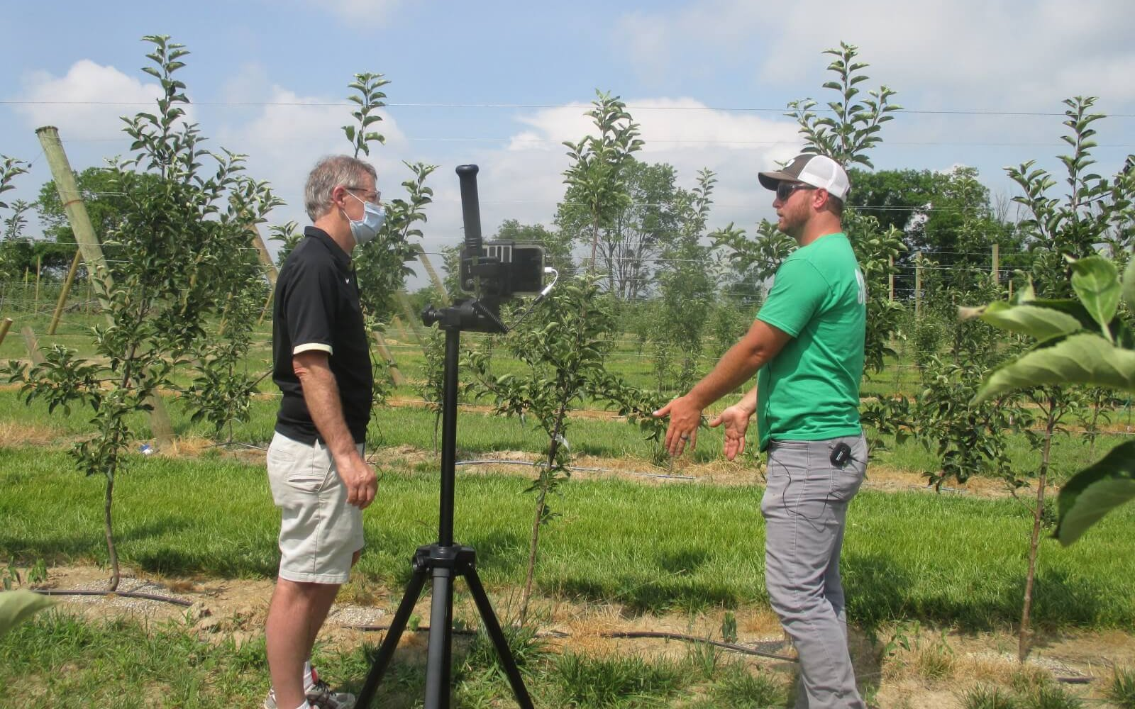Peter Hirst, Purdue Extension fruit specialist, speaks with Calvin Beasley, owner of Beasley's Orchard, during filming of the virtual fruit and vegetable field day.