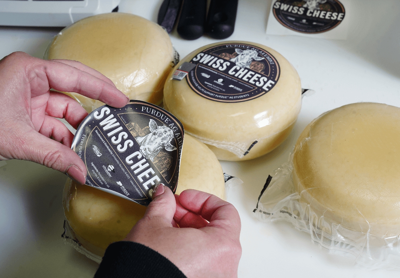 Putting on cheese label